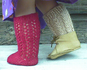 One each: red lace sock and camel cabled sock