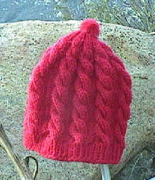 [A cabled cap in red.]