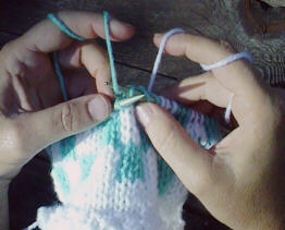 [Knitting with the left-hand yarn]