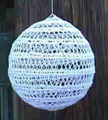 Free-standing knitted lace ball