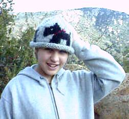 Knitting Niece Sara in the hat she made herself