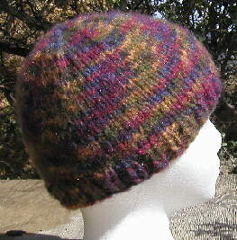 [Plainest version of the simple beanie cap in variegated yarn]